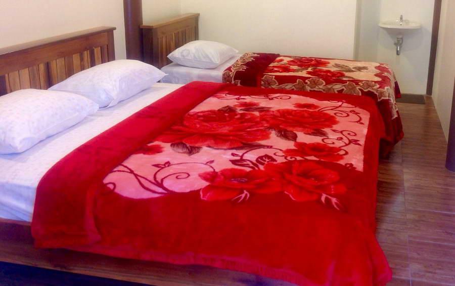 ห้องเตียงคู่ - บ้านทานตะวัน โฮมสเตย์ ปิล็อก